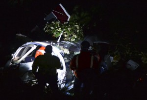 Rescuers inspect the wreckage of a Piper PA-60 Aerostar twin-engine aircraft that crashed on September 11, 2015 near  San Pedro de los Milagros , east from Medellin, Antioquia department, Colombia killing two crew members and injuring another. Two people died when a plane carrying crew members from a film starring Tom Cruise crashed in Colombia, aviation authorities and Universal Pictures said. AFP PHOTO / Raul ARBOLEDA