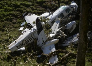 View of the wreckage of a Piper PA-60 Aerostar twin-engine aircraft that crashed on the eve,  on September 12, 2015 near San Pedro de los Milagros , east from Medellin, Antioquia department, Colombia  on September 12, 2015. killing two crew members and injuring another. Two people died when a plane carrying crew members from a film starring Tom Cruise crashed in Colombia, aviation authorities and Universal Pictures said. AFP PHOTO / Raul ARBOLEDA