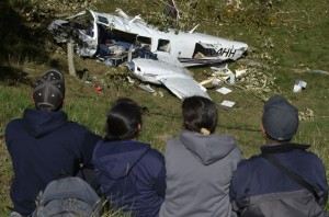 Peoplestare at  the wreckage of a Piper PA-60 Aerostar twin-engine aircraft that crashed on the eve,  on September 12, 2015 near San Pedro de los Milagros , east from Medellin, Antioquia department, Colombia  on September 12, 2015. killing two crew members and injuring another. Two people died when a plane carrying crew members from a film starring Tom Cruise crashed in Colombia, aviation authorities and Universal Pictures said. AFP PHOTO / Raul ARBOLEDA